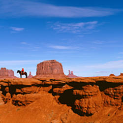 Person riding a horse on a landscape, Monument Valley, Arizona, USA
