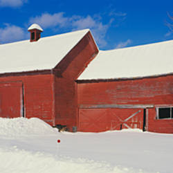 Barn in a snow covered landscape, Quechee, Vermont, USA