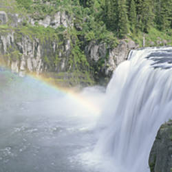 USA, Idaho, Targhee National Forest, Upper Mesa Falls, Aerial view of a rainbow over a waterfall