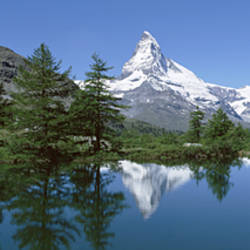Reflection of a mountain in a lake, Matterhorn, Riffelsee Lake, Pennine Alps, Zermatt, Valley, Switzerland