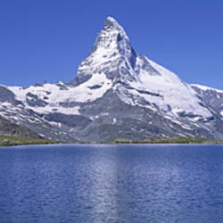 Panoramic View Of A Snow Covered Mountain By A Lake, Matterhorn, Zermatt, Switzerland