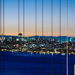 Close-up of a bridge with a city in the background, Golden Gate Bridge, San Francisco, California, USA