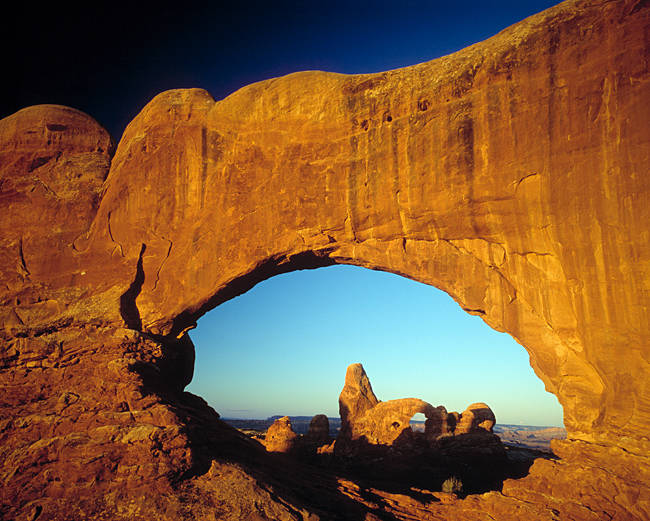 Turret arch viewed through North Window Arch, Arches National Park, Utah, USA