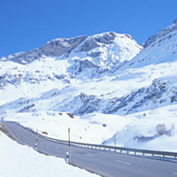 Snow covered mountains on both sides of a road, St Moritz, Graubunden, Switzerland