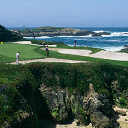 High angle view of people playing golf at a golf course, Cypress Point Club, Pebble Beach, Monterey County, California, USA