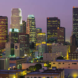 Skyscrapers lit up at dusk, City Of Los Angeles, California, USA