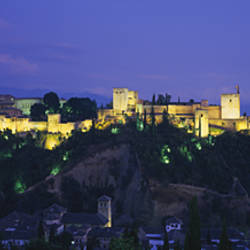 Palace lit up at dusk, Alhambra, Granada, Andalusia, Spain