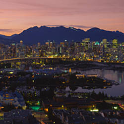 Aerial view of a city lit up at dusk, Vancouver, British Columbia, Canada