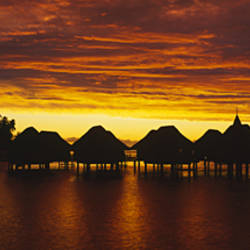 Silhouette of stilt houses on the beach, Bora Bora, French Polynesia