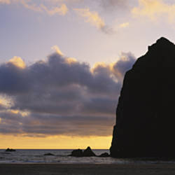 Silhouette of rocks at sunset, Cannon Beach, Oregon, USA