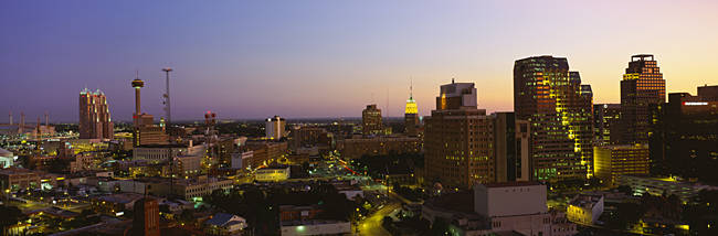 Buildings lit up at dusk, San Antonio, Texas, USA