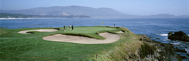 High angle view of people playing golf at a golf course, Pebble Beach Golf Links, Pebble Beach, California, USA