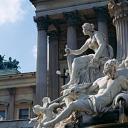 Low angle view of statues, Pallas Athena Fountain, Vienna, Austria