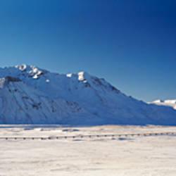 Pipeline passing through a snow covered landscape, Trans-Alaskan Pipeline, Brooks Range, Alaska, USA