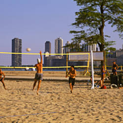 Group of people playing beach volleyball, Chicago, Illinois, USA