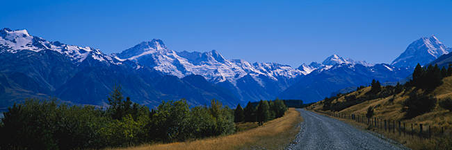 Empty road leading towards snowcapped mountains, Mt Cook, Southern Alps, New Zealand