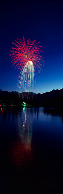 Firework display over a river, Bow River, Banff National Park, Alberta, Canada