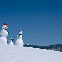 Low angle view of snowmen in snow covered landscape, Waterbury, Vermont, USA
