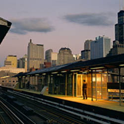 Person standing on a railroad station platform, Chicago, Illinois, USA