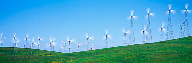Wind turbines spinning on hills, Altamont Pass, Livermore, California, USA
