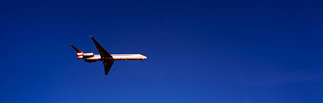 Low angle view of an airplane flying, McDonnell Douglas MD-80