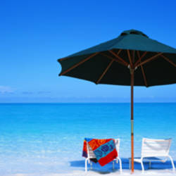 Chairs Under An Umbrella On The Beach, Turks And Caicos Islands, North Atlantic Ocean
