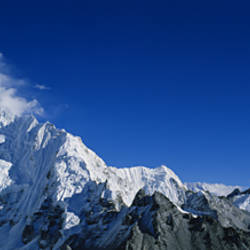 Low angle view of mountains covered with snow, Himalaya Mountains, Khumba Region, Nepal