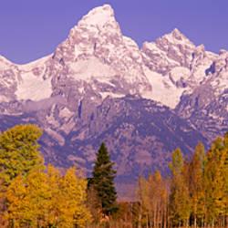 Snowcapped mountain range on a landscape, Teton Range, Grand Teton National Park, Wyoming, USA